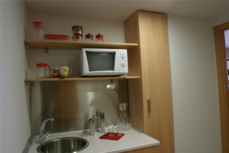 Shared kitchen between every two rooms
